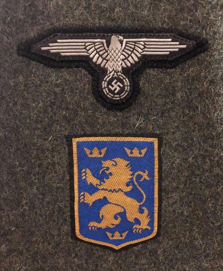 «Галицький левик» та орел СС на рукаві солдатського кітеля
