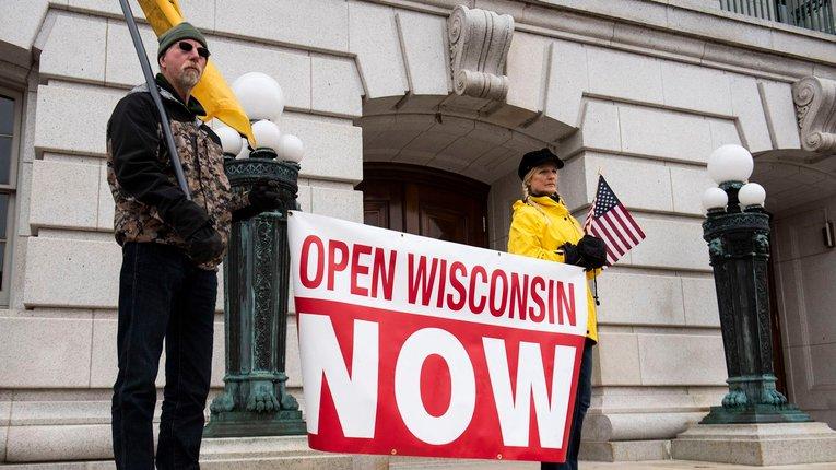«Карантинні бої» у США: Вісконсин послаблює обмеження, Мічиґан посилює